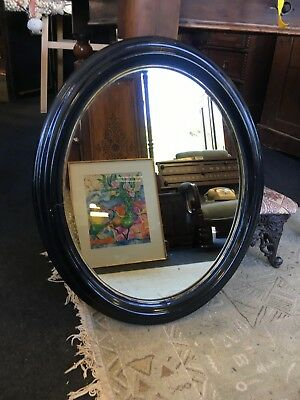 Antique Art Deco Ebonised And Gilt Wall Mounting Oval Mirror