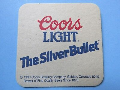1991 Coors Brewing Company Beer BAR PUB Coaster: Coors Light ~ The Silver Bullet