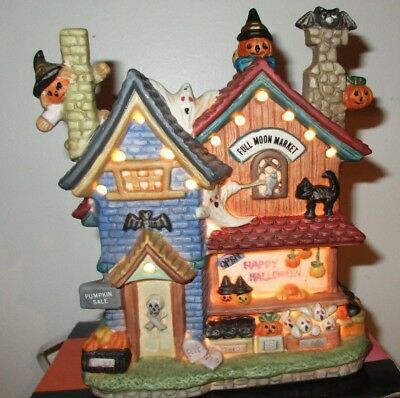 "Haunted Haven Lighted Hand Painted Porcelain Halloween ""Full Moon Market"" House"