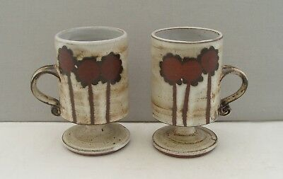 BRIGLIN STUDIO POTTERY PAIR OF FOOTED MUGS FLOWERS/TREES DECORATION 1960s 70s