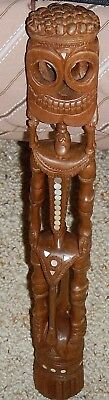 45 cm Tall Wooden Skeleton with Mother of Pearl Inlay from the Trobriand Islands