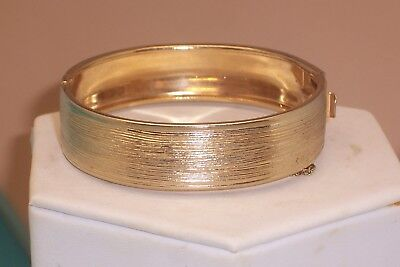 Vintage Pegasus Coro Brushed Gold Tone Hinged Bangle Bracelet With Safety Chain