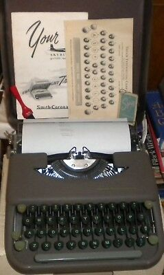 Smith-Corona Skyriter Typewriter w/metal case, manual, chart, brush