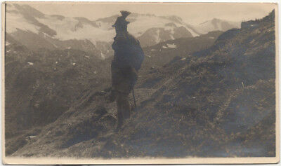 Rear view: hiker in Alpine/Bavarian/Tyrolean hat or Gamsbarthut, with Alps, 20s