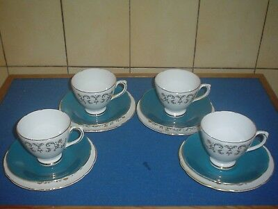 4 BEAUTIFUL 1950's FLORAL PATTERN ROYAL SUTHERLAND BONE CHINA TRIO'S