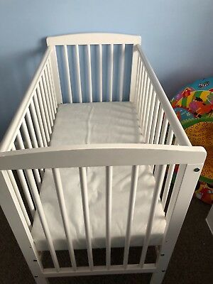 wooden cot with matress hardly used.