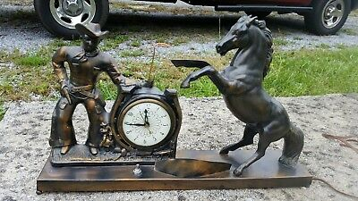 Vintage Cast Metal Cowboy and Horse Mantel Clock Light combo WORKING