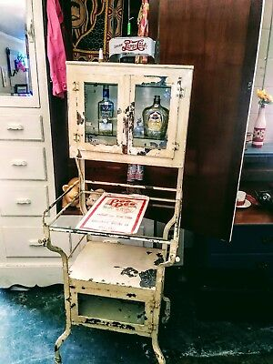 Vintage doctors cabinet metal and glass no broke or cracked glass.