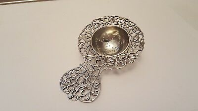 A Decrative Dutch 1932 Solid Silver Tea Strainer   46 grams  13cm long VGC