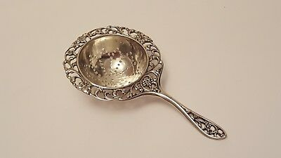 A Decrative Dutch 1931 Solid Silver Tea Strainer   22 grams  10.5cm long VGC