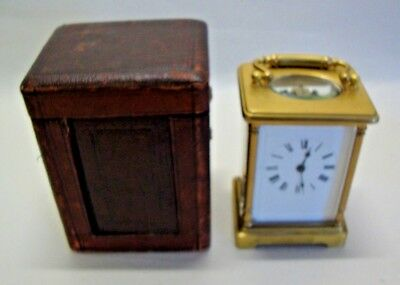 Antique brass cased carriage clock with traveling case
