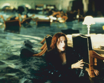 Kate Winslet in Titanic wades through flooded dining room 16x20 Poster
