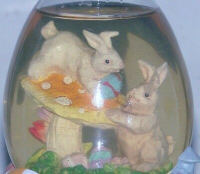 Easter bunny musical Snow Globe, hand painted resin, egg shaped dome