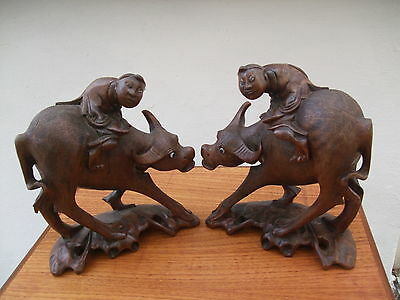 Antique Chinese A Pair Of Carved Hardwood Water Buffalo With Figure Sitting