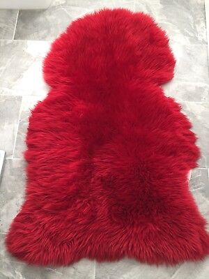 Small red sheepskin rug - Used