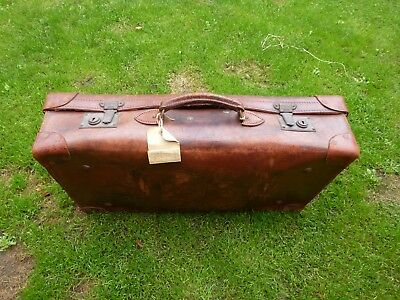 Vintage heavy leather suitcase
