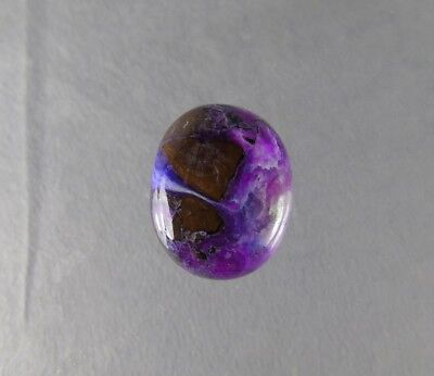 dkd#1/ 40cts  Partly gel Sugilite w/Richterite river flowing out.