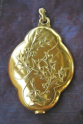 Beautiful antique French Art Nouveau brass sliding locket with Holly & Berries