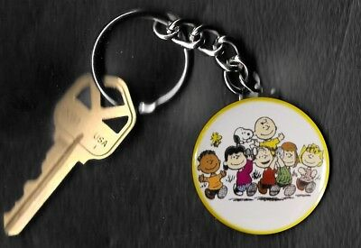Peanuts Gang carrying Charlie Brown Peanuts by Charles Schulz Key Chain KEYCHAIN
