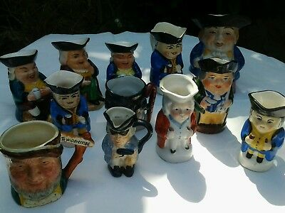 12 x Character jugs,  different makers.