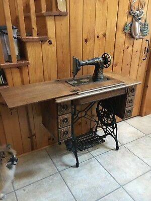 Antique Singer 1910 Red Eye Treadle Sewing Machine Oak Cabinet with 7 Drawers