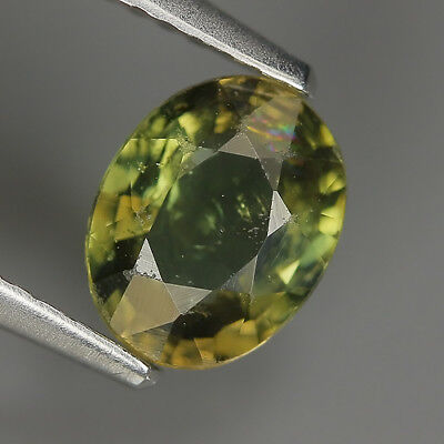 0.98 Ct Natural Unheated Greenish Yellow KORNERUPINE Oval Gem @ See Vide!