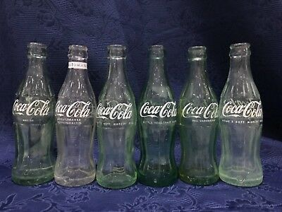 Coca Cola bottles 6 bottles for different countries old