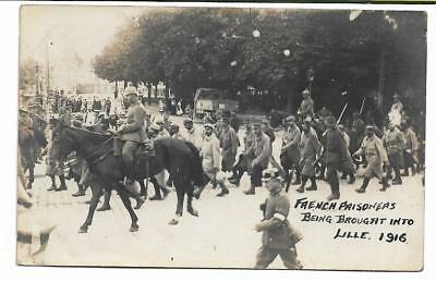 WW1 POSTCARD  'FRENCH PRISONERS BEING BROUGHT INTO LILLE 1916'  unused