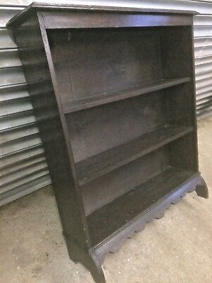 Old antique Edwardian period solid oak bookcase with scalloped bottom