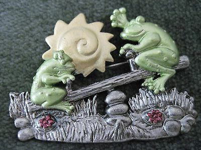 "Whimsical frogs on a seesaw brooch pin, 2"" X 1.5,"" signed ""DD"""