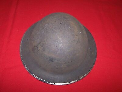 WWII British helmet shell with chin strap, dated 1943