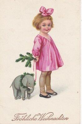 Little girl with Toy elephant & fir branch