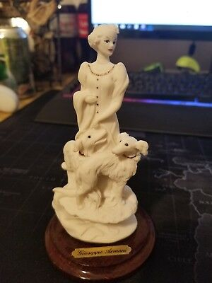 G armani figurine women with two dogs
