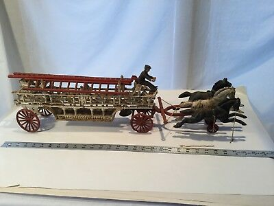Vtg Antique Cast Iron Horse Drawn Fire Truck 3 horses wagon 1 driver 3 Ladders