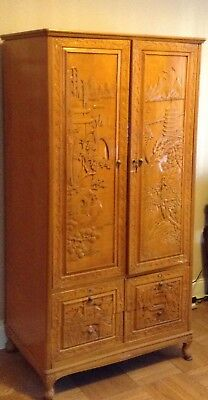 Lovely hand-carved armoire. Solid oak with Asian influence.