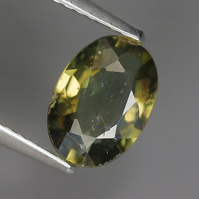 1.25 Ct Natural Unheated Greenish Yellow KORNERUPINE Oval Gem @ See Vide!
