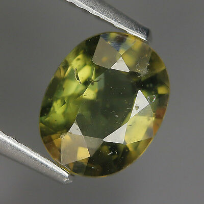 1.39 Ct Natural Unheated Greenish Yellow KORNERUPINE Oval Gem @ See Vide!