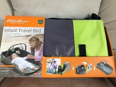 New Eddie Bauer durable Infant travel bed green and gray in color