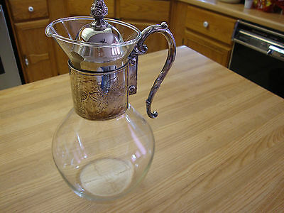 One Silverplated Ten Cups Carafe