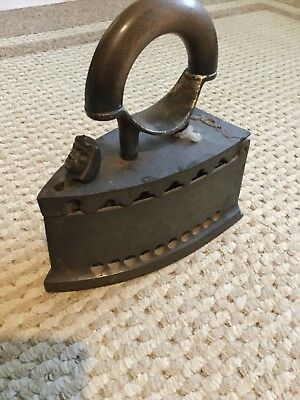 ANTIQUE CAST IRON HOT COAL IRON with Wood Handle & Metal clasps & a head on it