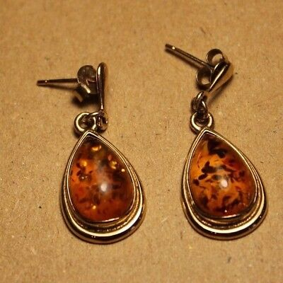 Ladies 9ct gold earrings set with natural amber