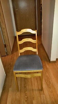 Vintage wooden folding chair with padded seat. Made from hard wood.