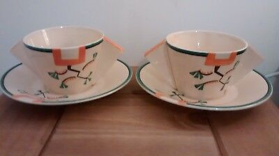"Two art deco clarice cliff bizarre ""ravel"" two handled cups & saucers 1930."