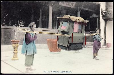 CHINA c.1907-1910's Porters, two men carrying a traveling sedan chair - H/c