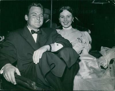 John Agar with Susan Morrow during an event. - Vintage photo