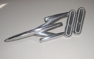 Vintage 1956 Oldsmobile Rocket 88 Fender Insignia Ornament, Chrome Car Badge