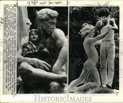 1974 Press Photo People pose with statues, New York - piw04233