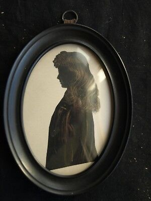 Miniature silhouette half length portrait of a young girl c1850