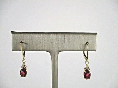 14K Yellow Gold Earrings With 2 Oval Pink Tourmaline and 6 Round Diamonds