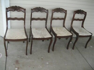 Vintage carved rose back cherry dining room chairs by Consider H.Willett Inc.